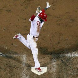 Philadelphia Phillies' Michael Martinez reacts as he scores on a wild pitch by Miami Marlins starting pitcher Wade LeBlanc in the fifth inning of a baseball game, Monday, Sept. 10, 2012, in Philadelphia. Philadelphia won 3-1.