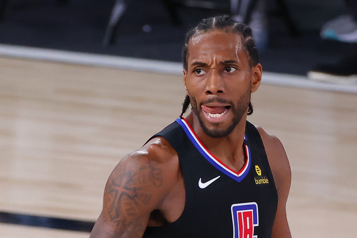 Kawhi Leonard of the LA Clippers reacts after being charged with an offensive foul against the Dallas Mavericks during the third quarter in Game Six of the Western Conference First Round during the 2020 NBA Playoffs at AdventHealth Arena at ESPN Wide World Of Sports Complex on August 30, 2020 in Lake Buena Vista, Florida.