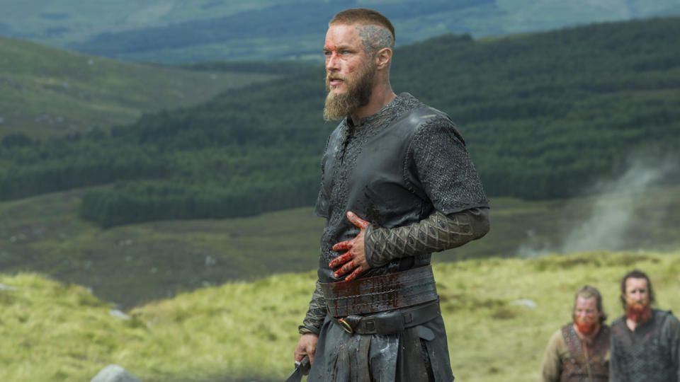 Ragnar (Travis Fimmel) holds a bloody hand to his stomach in a screenshot from Vikings