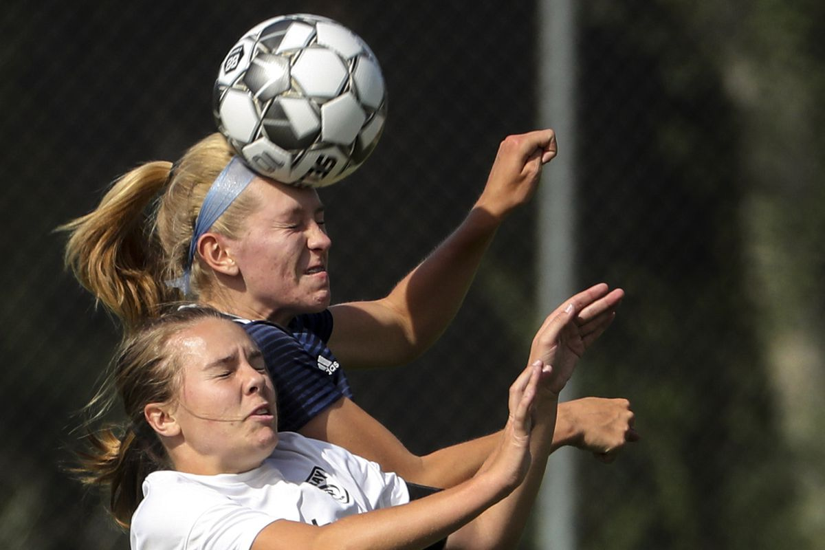 Skyline's Laura Cookson leaps above Murray's Sydney Wilcken and heads the ball upfield during a Region 6 girls soccer game at Skyline High School in Salt Lake City on Tuesday, Sept. 17, 2019. Skyline won 3-0.