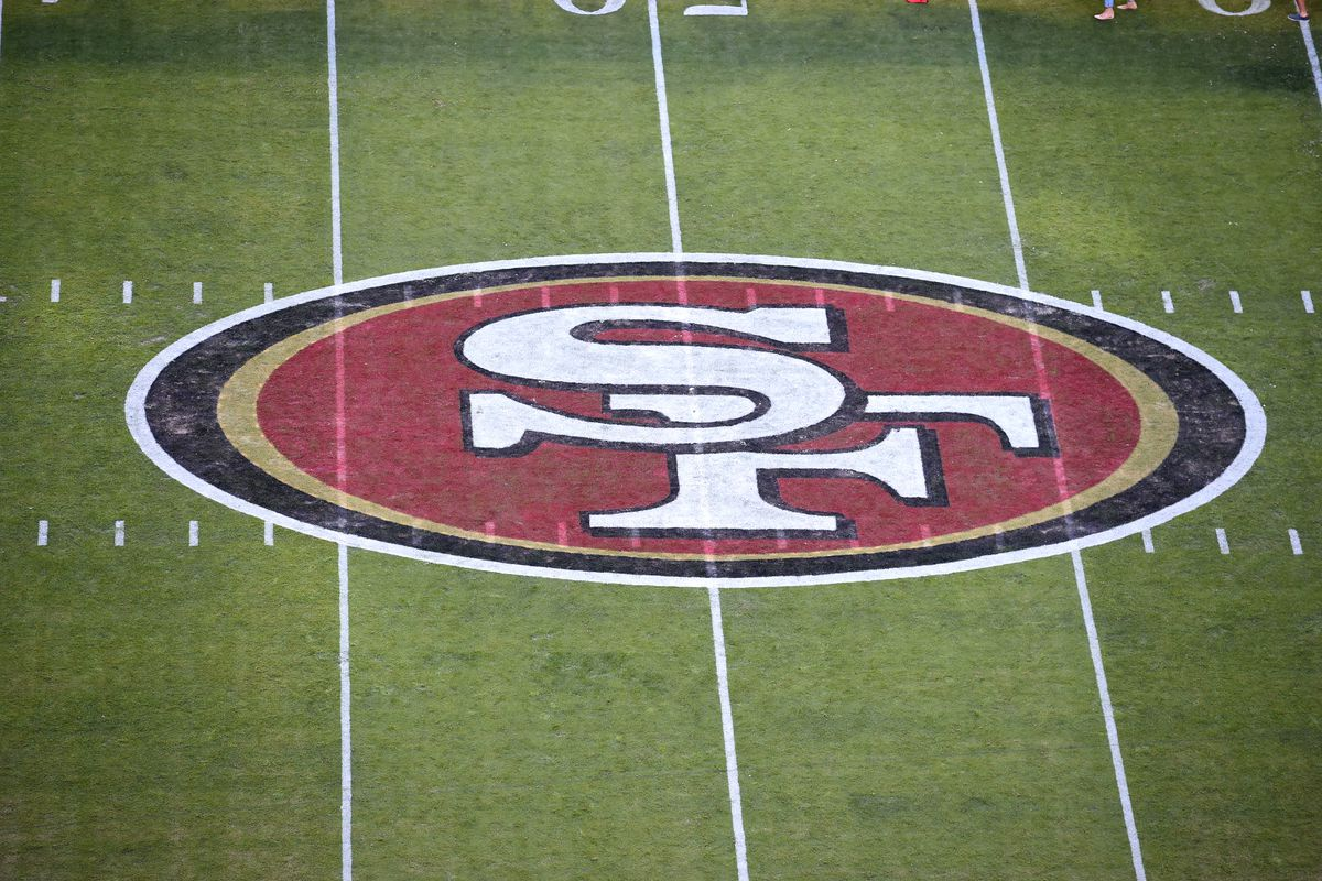 The San Francisco 49ers logo painted on the field at the 50 yard line during an NFL game between the Los Angeles Rams and the San Francisco 49ers on September 21, 2017 at Levi's Stadium in Santa Clara, CA.