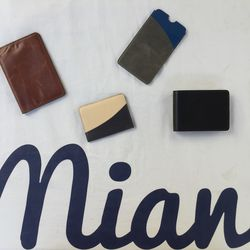 Leather goods pictured are $60, minus the blue and green item which is $25