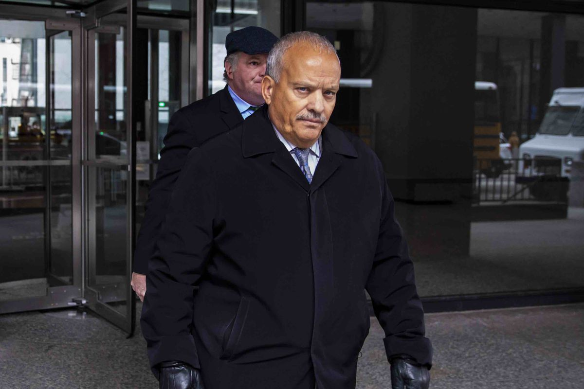 Former state Rep. Luis Arroyo on Tuesday walks out of the Dirksen Federal Court Building after pleading not guilty to a charge of bribery.