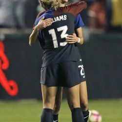 United States' Lynn Williams (13) receives a hug from teammate Ashley Hatch, rear, following the team's 4-0 win over Switzerland in an international friendly soccer match Wednesday, Oct. 19, 2016, in Sandy, Utah.  (AP Photo/Rick Bowmer)