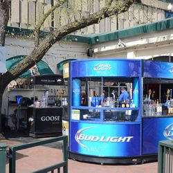 2:55 p.m. Moveable beer stand next to the Captain Morgan Club -