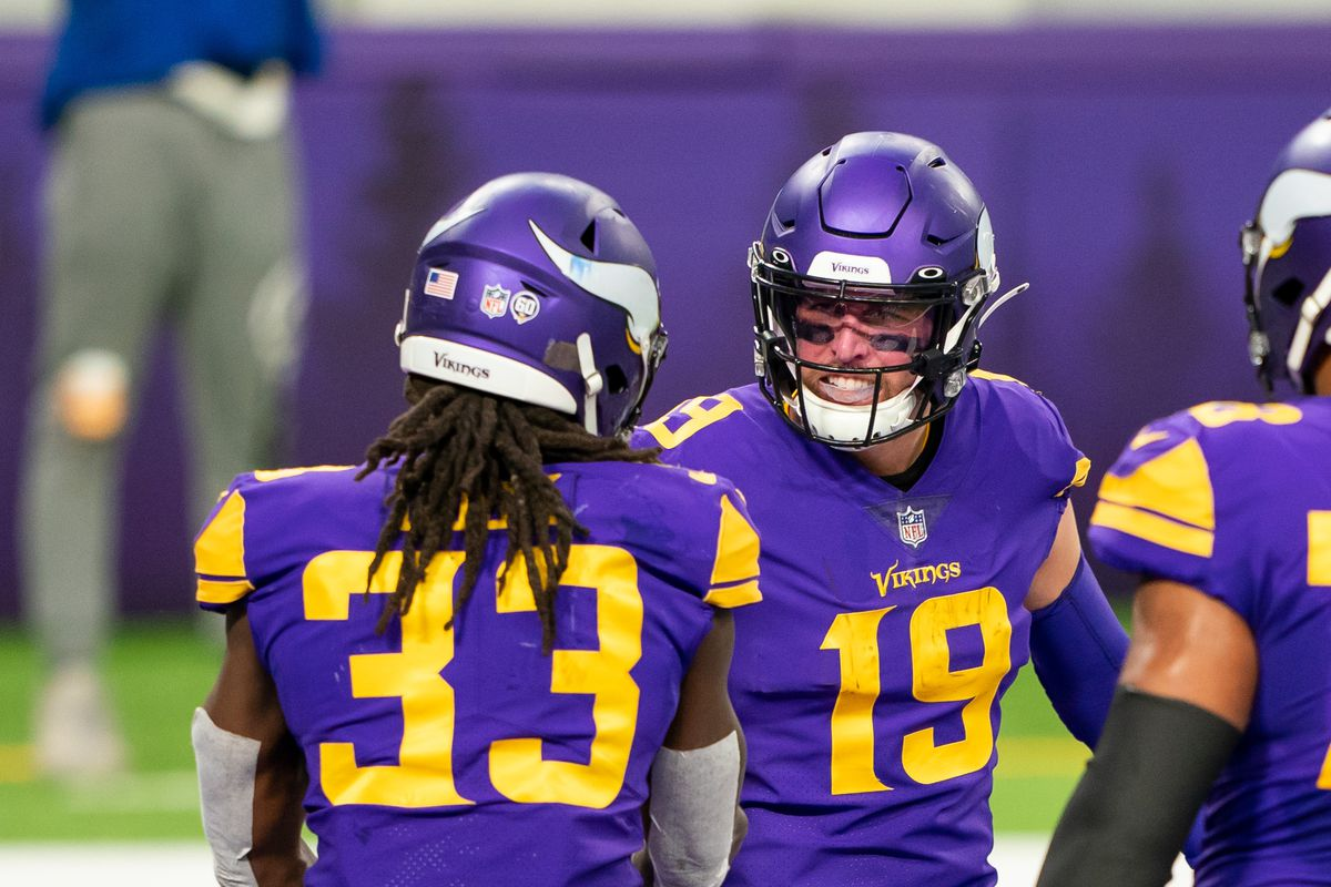 Minnesota Vikings running back Dalvin Cook (33) celebrates with wide receiver Adam Thielen (19) after scoring a touchdown against the Dalles Cowboys in the first quarter at U.S. Bank Stadium.