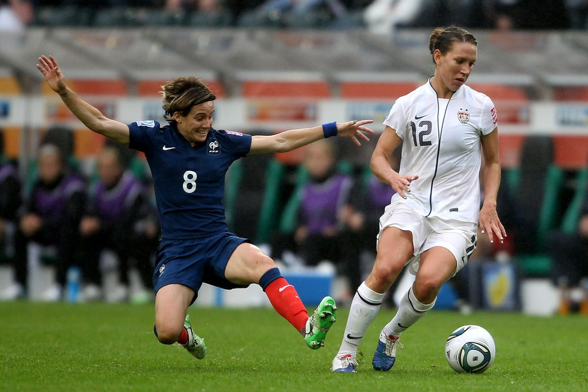 Bruin Lauren Cheney avoids a tackle in the match against France. The US will need to control play through midfield in today's final against Japan.  (Photo by Scott Heavey/Getty Images)