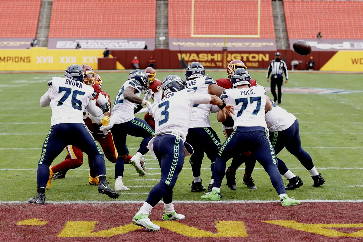 Russell Wilson #3 of the Seattle Seahawks attempts a pass against the Washington Football Team at FedExField on December 20, 2020 in Landover, Maryland.