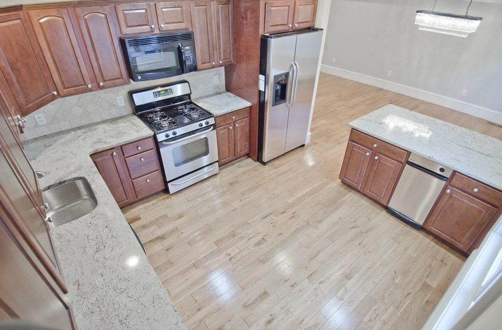 A modern spacious kitchen as viewed from the ceiling.