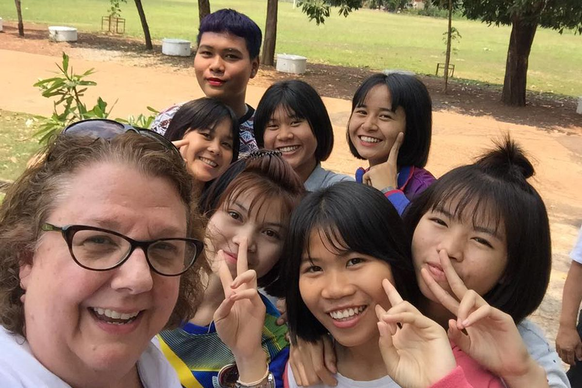 Kelly Bentley posted a photo of herself and Thai students on Facebook. The students hosted American teens enrolled in a study abroad program IPS could join.