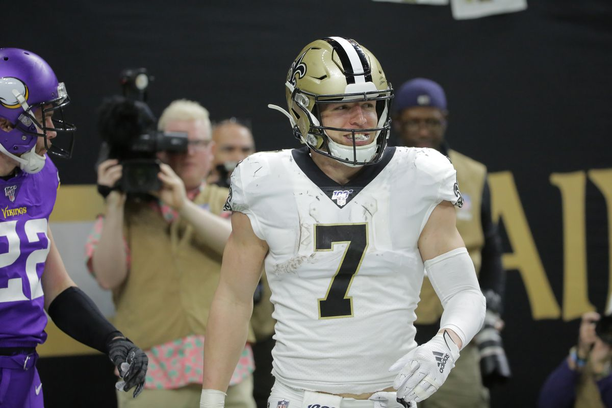 New Orleans Saints quarterback Taysom Hill reacts after catching a pass for a touchdown against the Minnesota Vikings during the fourth quarter of a NFC Wild Card playoff football game at the Mercedes-Benz Superdome.