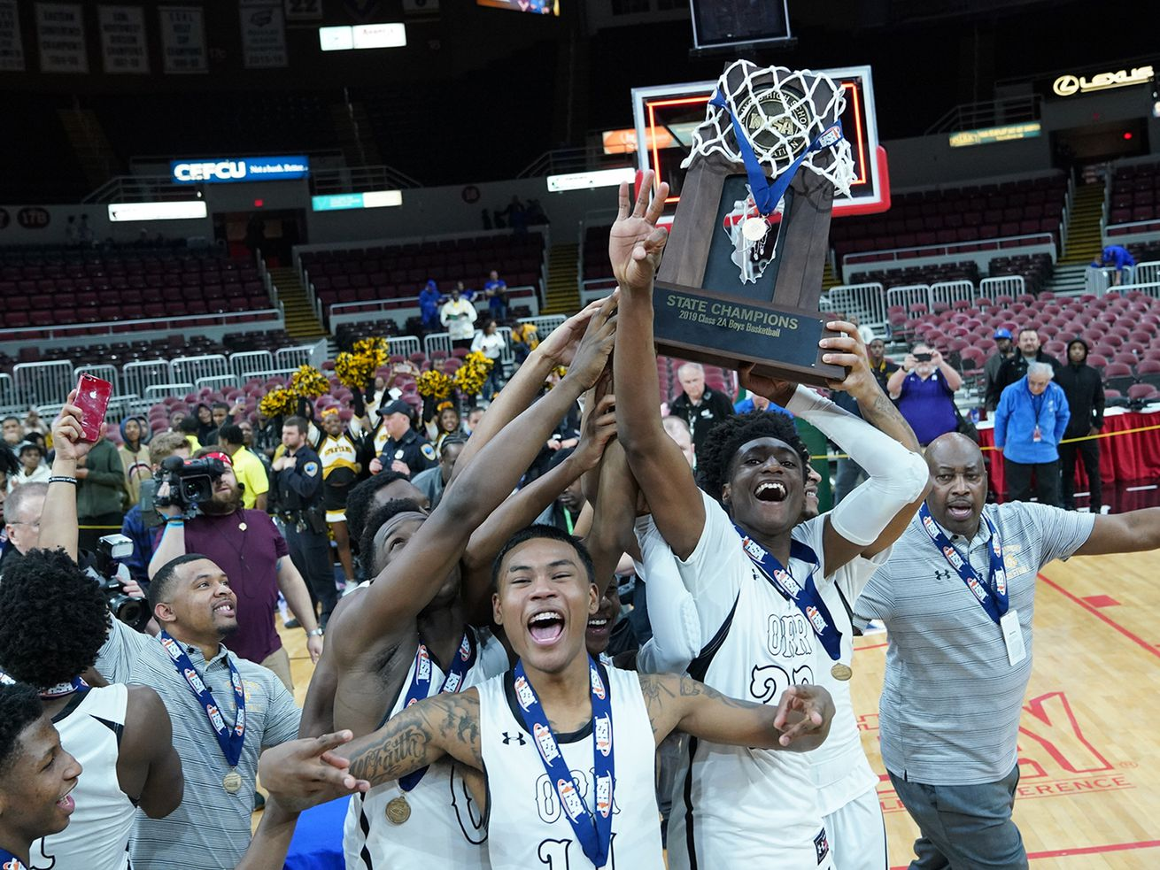 Orr holds up the Class 2A state championship trophy in 2019.