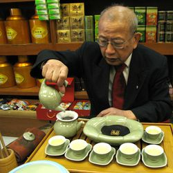 Frank Fine performs a traditional Chinese tea ceremony in his tea shop.  Sun-Times Archives