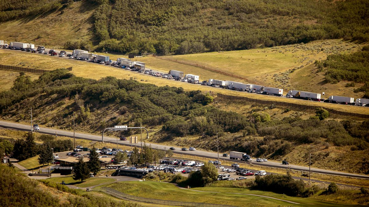 Traffic west bound on I-80 builds up as aircraft battle the Parley's Canyon fire west of Park City on Saturday, Aug. 14, 2021.