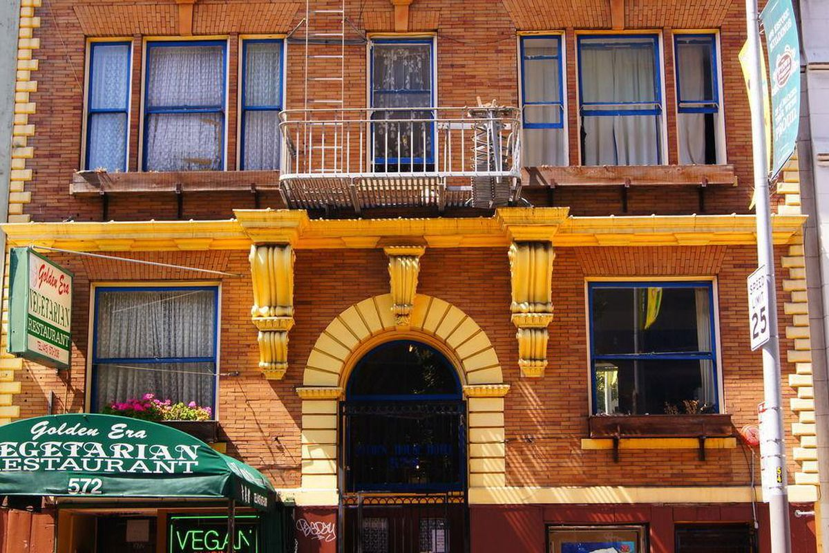 The brick front of the circa 1900 Sweden House Hotel in the Tenderloin.
