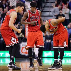 Chicago Bulls guard Derrick Rose (1) takes a bow after hitting a shot against the Jazz during NBA basketball in Salt Lake City, Monday, Feb. 1, 2016. At left are Chicago Bulls forward Doug McDermott (3) and guard Jimmy Butler (21)