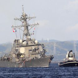 The damaged USS Fitzgerald is being towed by a tugboat near the U.S. Naval base in Yokosuka, southwest of Tokyo, after the U.S. destroyer collided with the Philippine-registered container ship ACX Crystal in the waters off the Izu Peninsula Saturday, June 17, 2017. Crew members from the destroyer USS Dewey were helping stabilize the damaged USS Fitzgerald after its collision off the coast of Japan before dawn Saturday, leaving seven sailors missing and at least three injured. (AP Photo/Eugene Hoshiko)