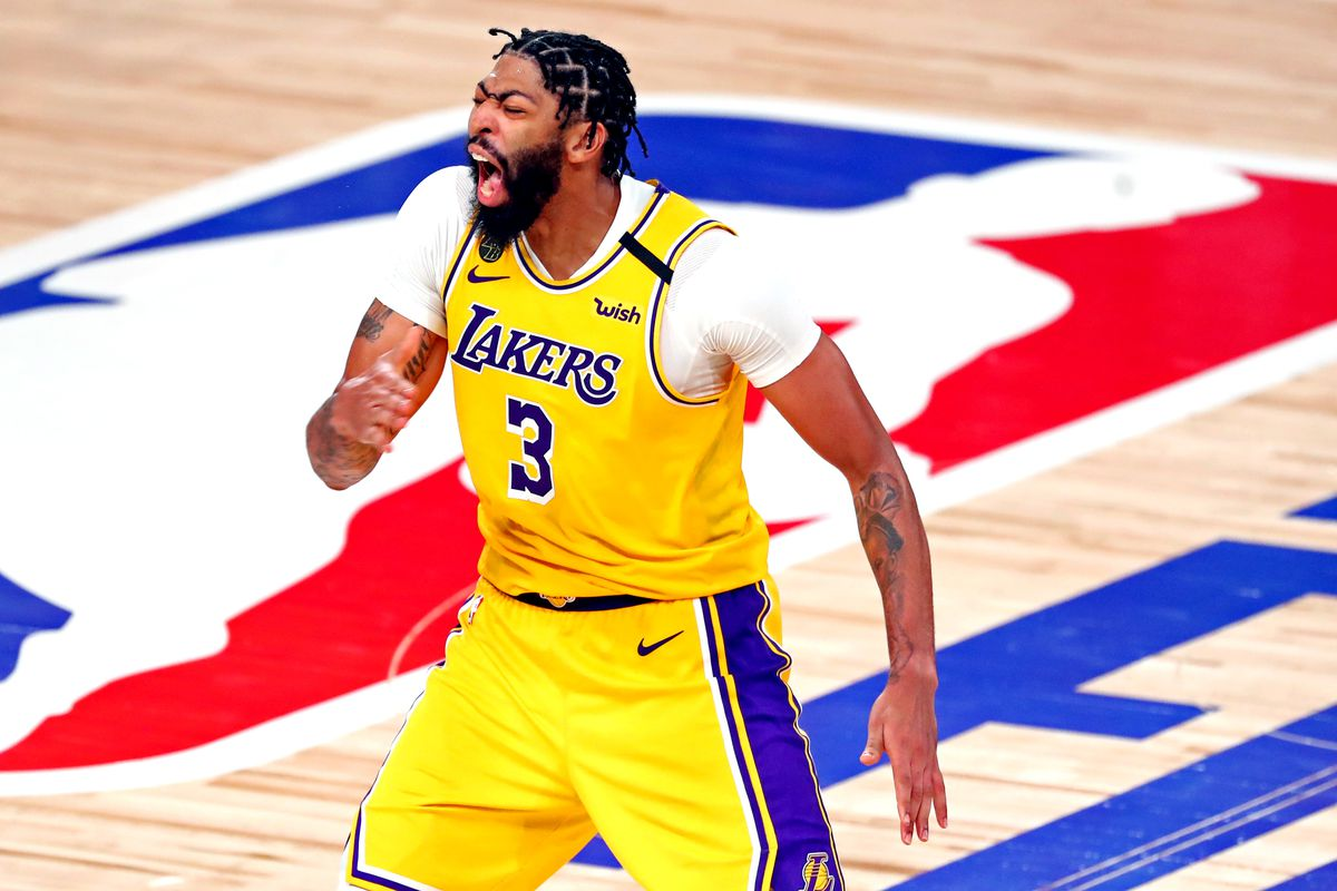 Los Angeles Lakers forward Anthony Davis celebrates after making a three pointer during the fourth quarter against the Miami Heat in game 4 of the 2020 NBA Finals at AdventHealth Arena.