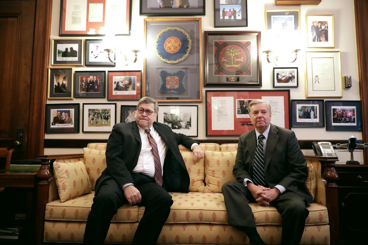 Attorney general nominee William Barr sits with Sen. Lindsey Graham in January 2019.