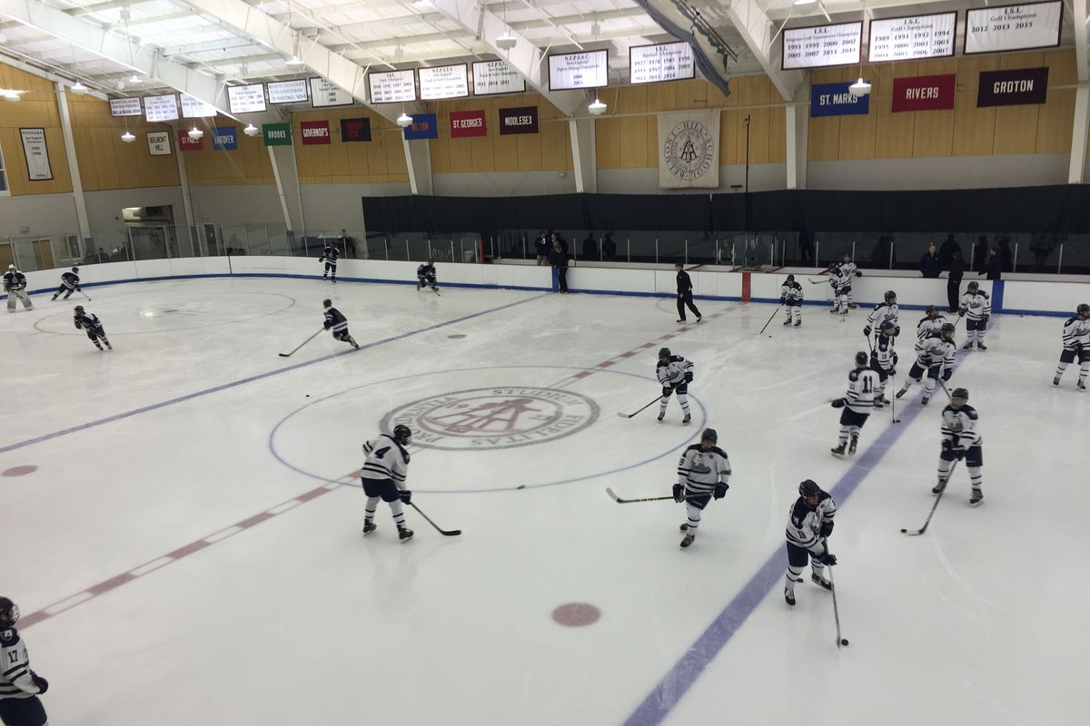 Nobles players warm up before Saturday's game at Belmont Hill.