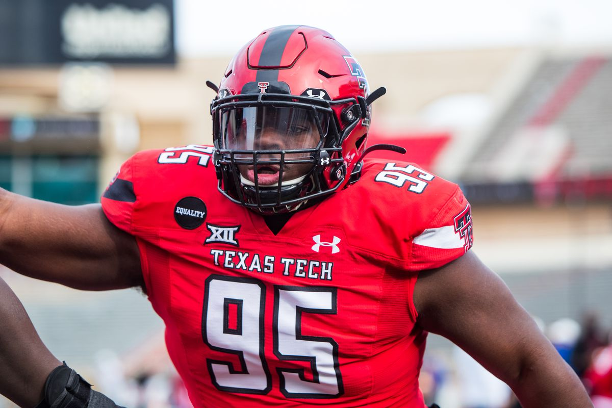 Defensive lineman Jaylon Hutchings of the Texas Tech Red Raiders warms up before the college football game against the Kansas Jayhawks at Jones AT&T Stadium on December 05, 2020 in Lubbock, Texas.