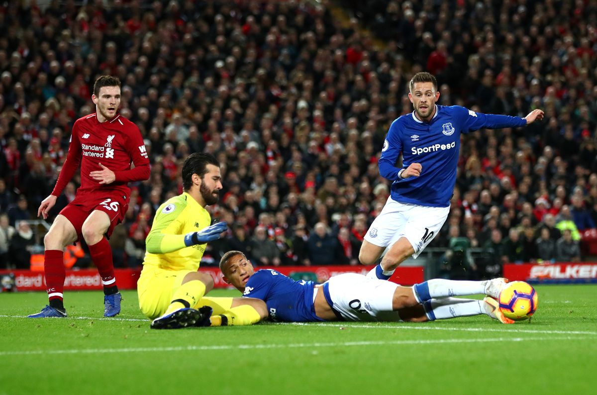Richarlison and Gylfi Sigurdsson battle for possession with Alisson Becker and Andy Robertson - Liverpool FC v Everton FC - Premier League
