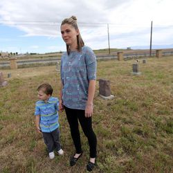 Tessa Stitzer, with her son, Drake, talks about family members buried at the Bingham City Cemetery in Copperton on Thursday, May 25, 2017. The Jordan School Board has deeded the pioneer cemetery to Copperton Township after 44 years as owner and caretaker. Stitzer serves on the township council and was insistent that the township reassume ownership.