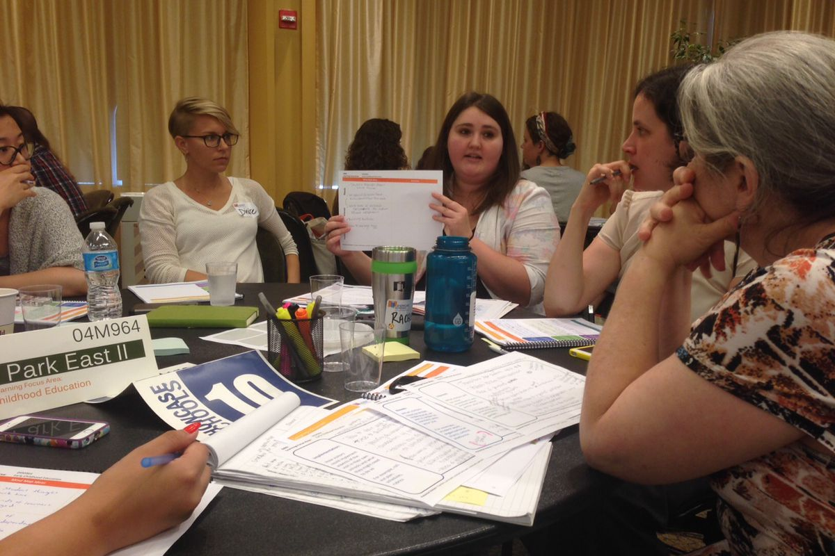 Christina Cordell, a director for the Showcase Schools program, works with Central Park East II Principal Naomi Smith, right, at conference on Tuesday.