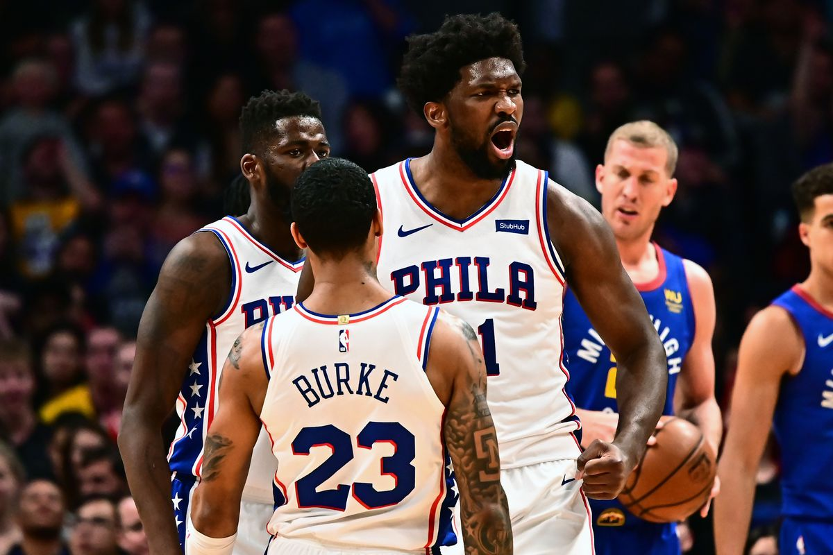 Philadelphia 76ers center Joel Embiid reacts to his basket and a foul Witt guard Trey Burke in the second half against the Denver Nuggets at the Pepsi Center.