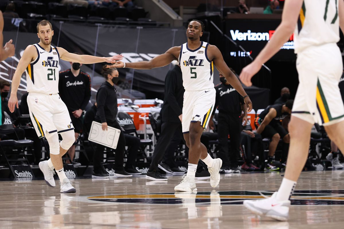 Matt Thomas #21 of the Utah Jazz high fives Jarrell Brantley #5 of the Utah Jazz during the game against the San Antonio Spurson May 5, 2021 at vivint.SmartHome Arena in Salt Lake City, Utah.