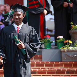 Southern Virginia University graduate Blair Jones walks with his diploma in hand at commencement exercises on April 27, 2013.