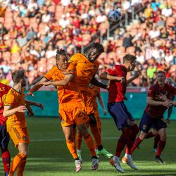 Real Salt Lake and Houston Dynamo players fight for the ball as RSL and Houston play an MLS soccer game at Rio Tinto Stadium in Sandy on Saturday, June 26, 2021.