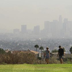 On what would otherwise be a fairly clear day, the downtown Los Angeles skyline is obscured by smoke from wildfires in the Angeles National Forest, seen from the Baldwin Hills area of Los Angeles Tuesday, Sept. 4, 2012. It could be a week before firefighters can contain a the 3,600-acre blaze because of high temperatures and rugged terrain in thick brush that hasn't burned in a couple of decades. The cause of the fire that started Sunday afternoon in the San Gabriel Mountains, spoiling holiday hiking and camping plans for thousands, has not been determined.