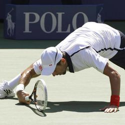 Serbia's Novak Djokovic falls while attempting to return a shot to Spain's David Ferrer during a semifinal match at the 2012 US Open tennis tournament, Sunday, Sept. 9, 2012, in New York.