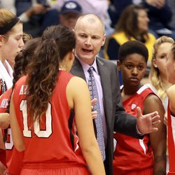 Utah head coach Anthony Levrets talks to his team during a women's basketball game at the Marriott Center in Provo on Saturday, Dec. 14, 2013. Utah won in double overtime 82-74.