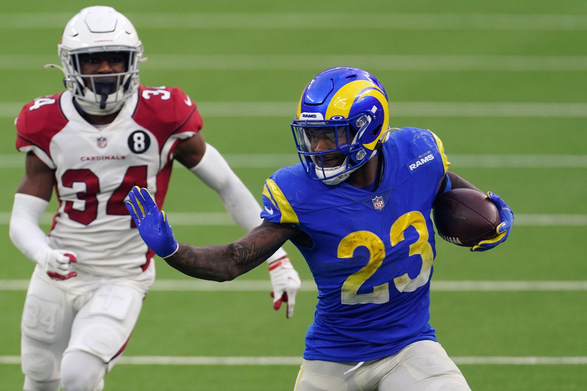 Los Angeles Rams running back Cam Akers (23) is pursued by Arizona Cardinals free safety Jalen Thompson (34) in the second half at SoFi Stadium. The Rams defeated the Cardinals 18-7.