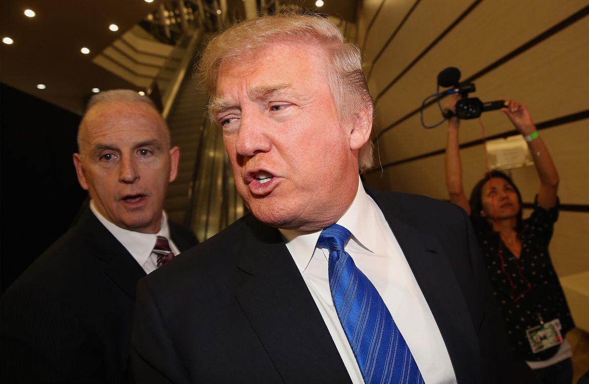 Trump and his bodyguard Keith Schiller attend the final round of the Miss  Universe competition in Crocus City Hall in Moscow on November 9, 2013.