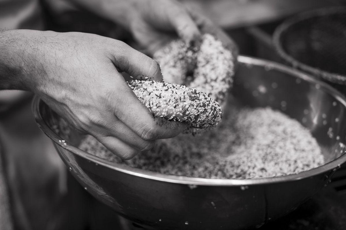 Seeding bagels at Beauty's Bagel Shop