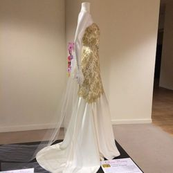 """<a href=""""http://www.oliviahwang.com/"""">Olivia Hwang's</a> design pays homage to the daffodil. """"I constructed a light ivory Charmeuse inner structure and layered a gold, delicate Chantilly lace on top,"""" she said. Daffodils are also called narcissus. Inspire"""