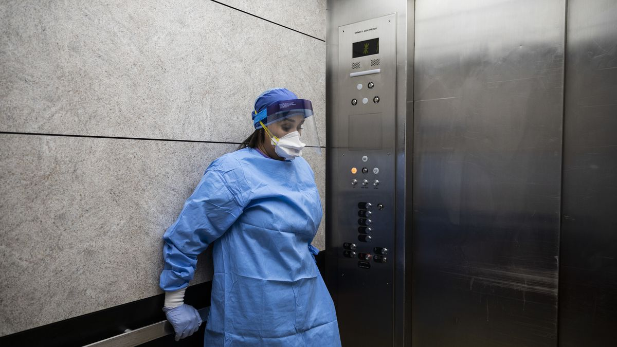 Nurse practitioner Capri Reese takes a minute to herself in an elevator after an 80-year-old man suffering from COVID-19 died at Roseland Community Hospital in April.