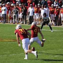 Jax Welch (30) watches the moment before contact by Iowa State's Chris Francis (41).