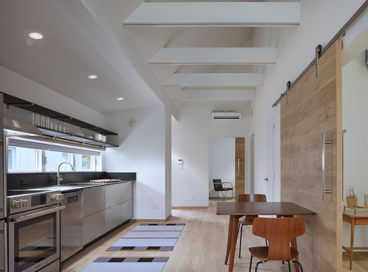 Kitchen with modern appliances and small dining table.