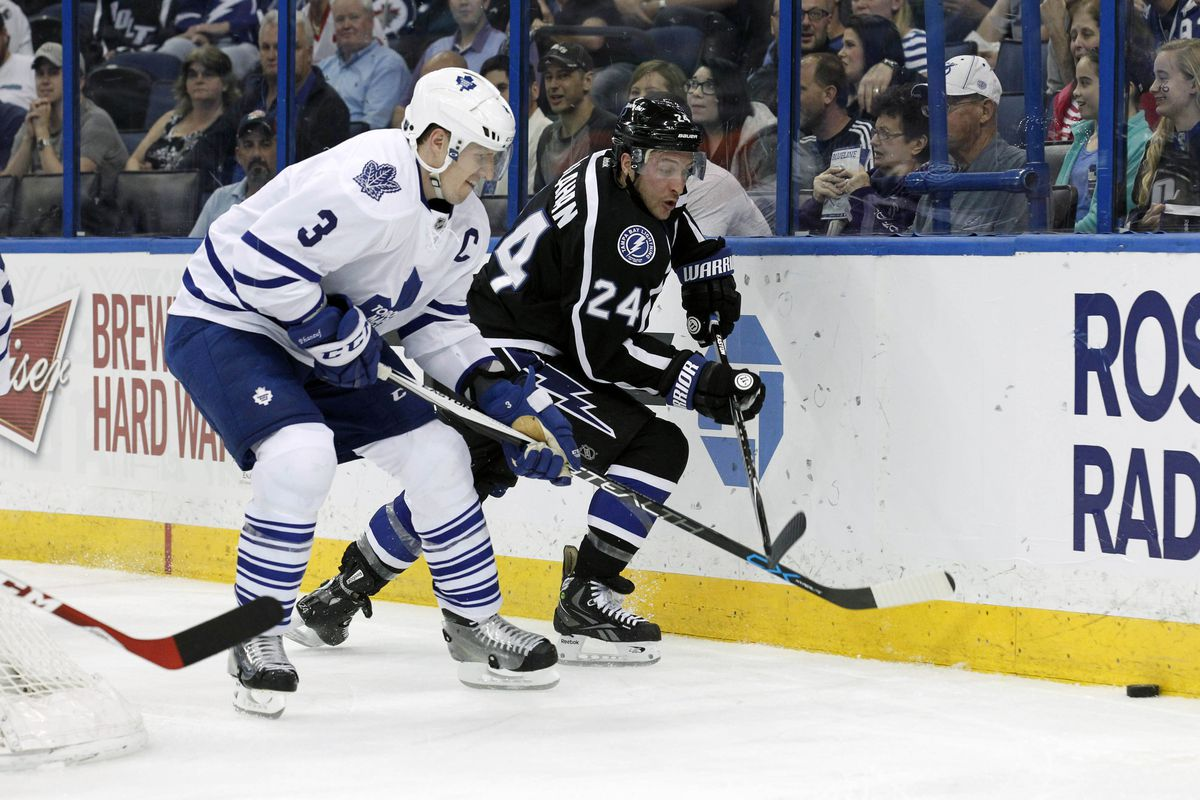 Toronto's Dion Phaneuf and Tampa Bay's Ryan Callahan chase the puck during the Lightning's 4-2 win Thursday night.