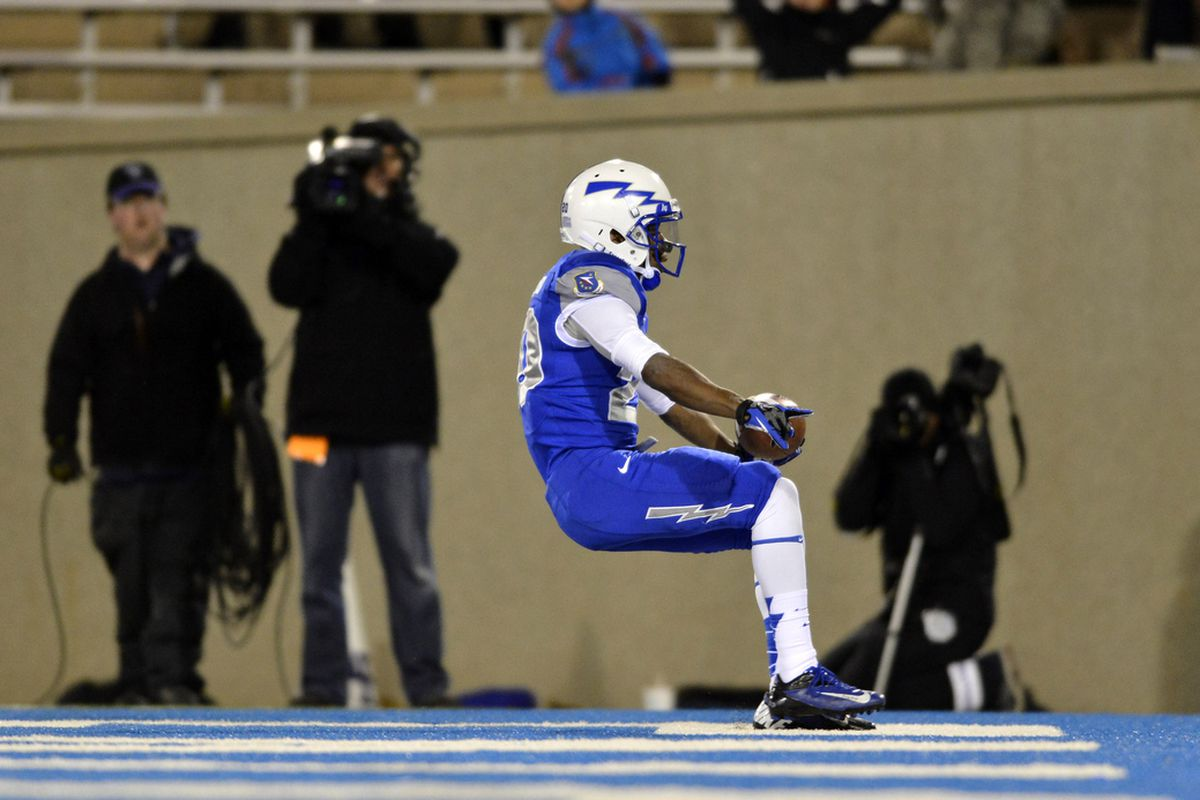 Oct 26, 2012; Colorado Springs, CO, USA; Air Force Falcons wide receiver Dontae Strickland (20) reacts after his twelve yard rushing touchdown in the second quarter of the game against the Nevada Wolf Pack at Falcon Stadium.