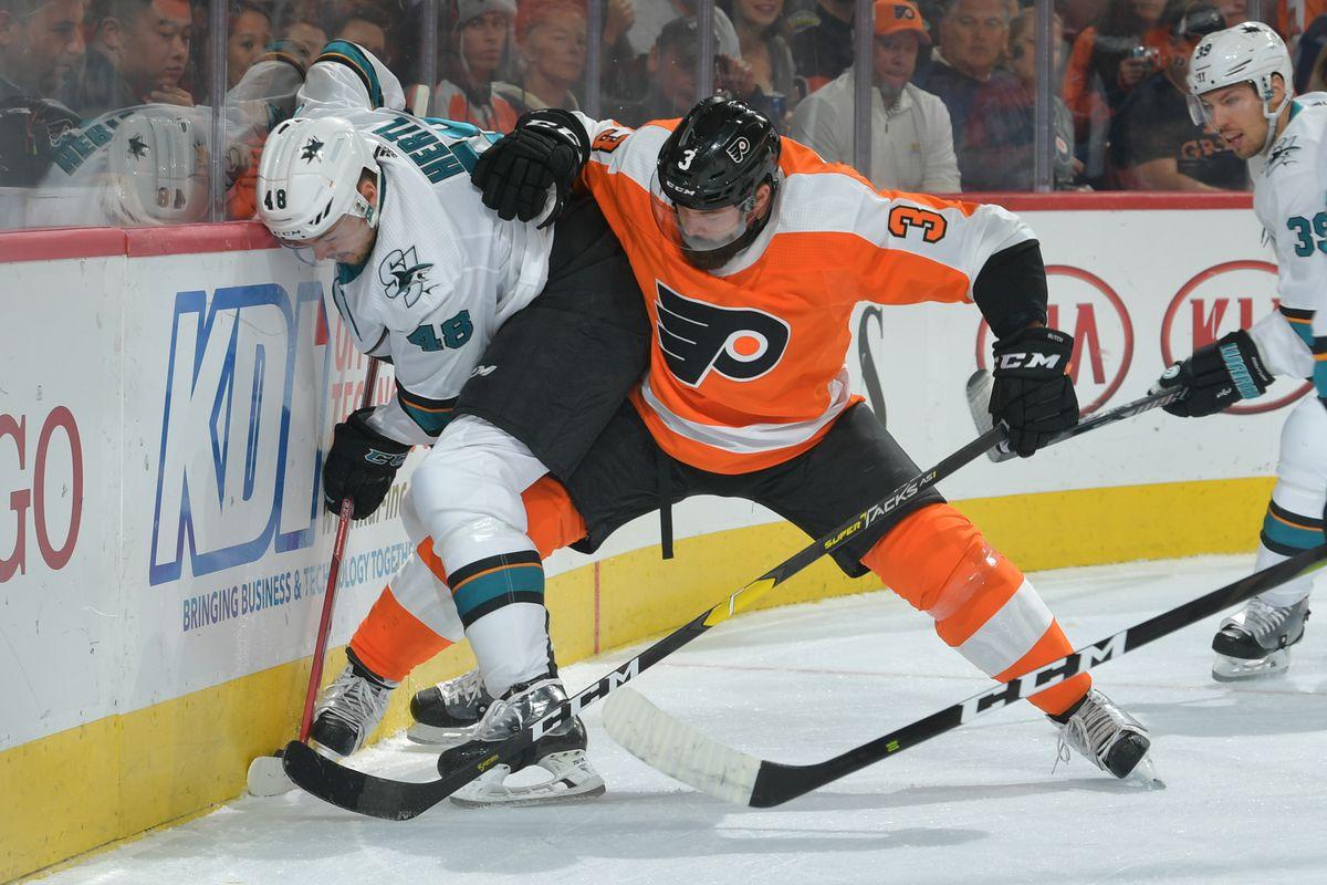 PHILADELPHIA, PA - OCTOBER 09: Tomas Hertl #48 of the San Jose Sharks and Radko Gudas #3 of the Philadelphia Flyers fight for the puck at the Wells Fargo Center on October 9, 2018 in Philadelphia, Pennsylvania.