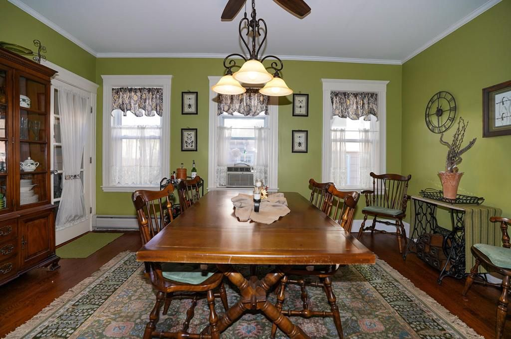 A dining room with a long table and chairs.