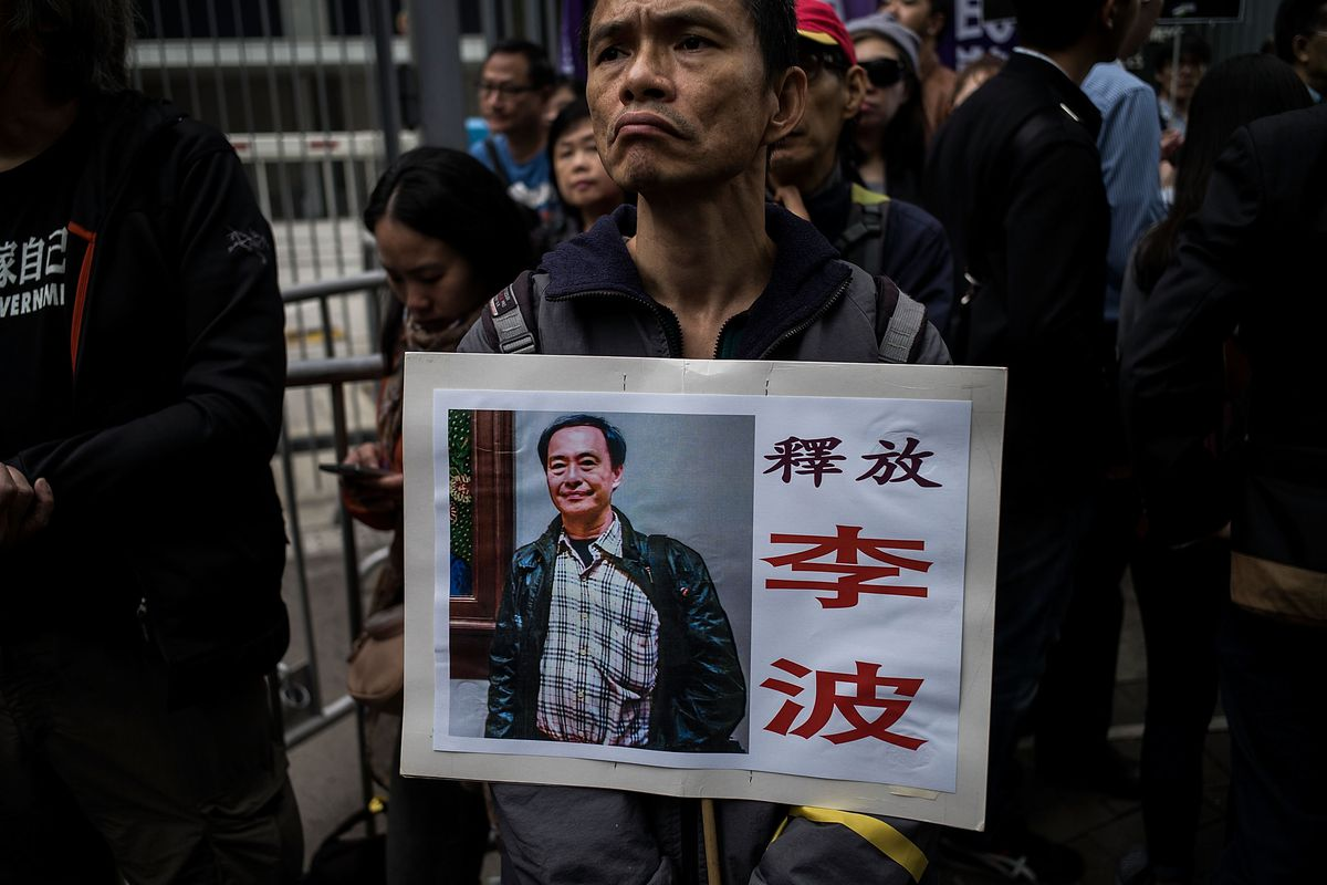 A Hong Kong protestor holds up a picture of Lee Bo, one of the disappeared booksellers.