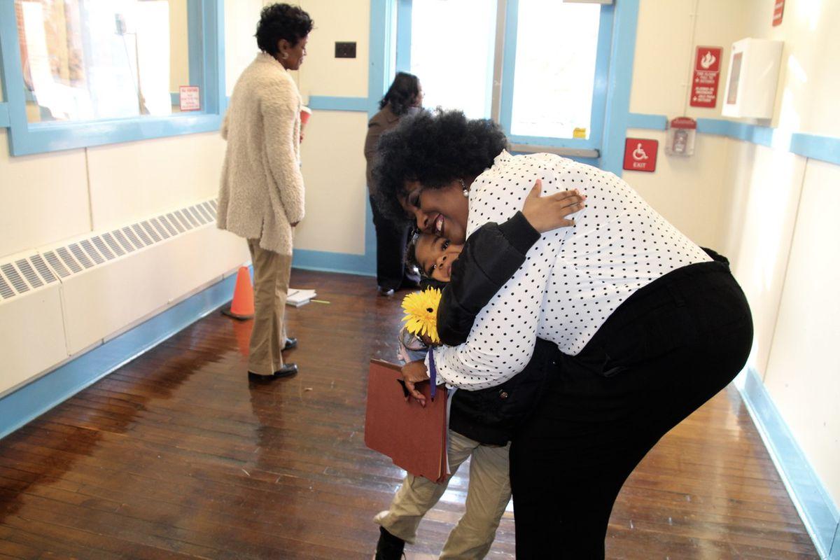 Stephenie Washington greets dozen of students at Georgian Hills Achievement Elementary School Monday morning.