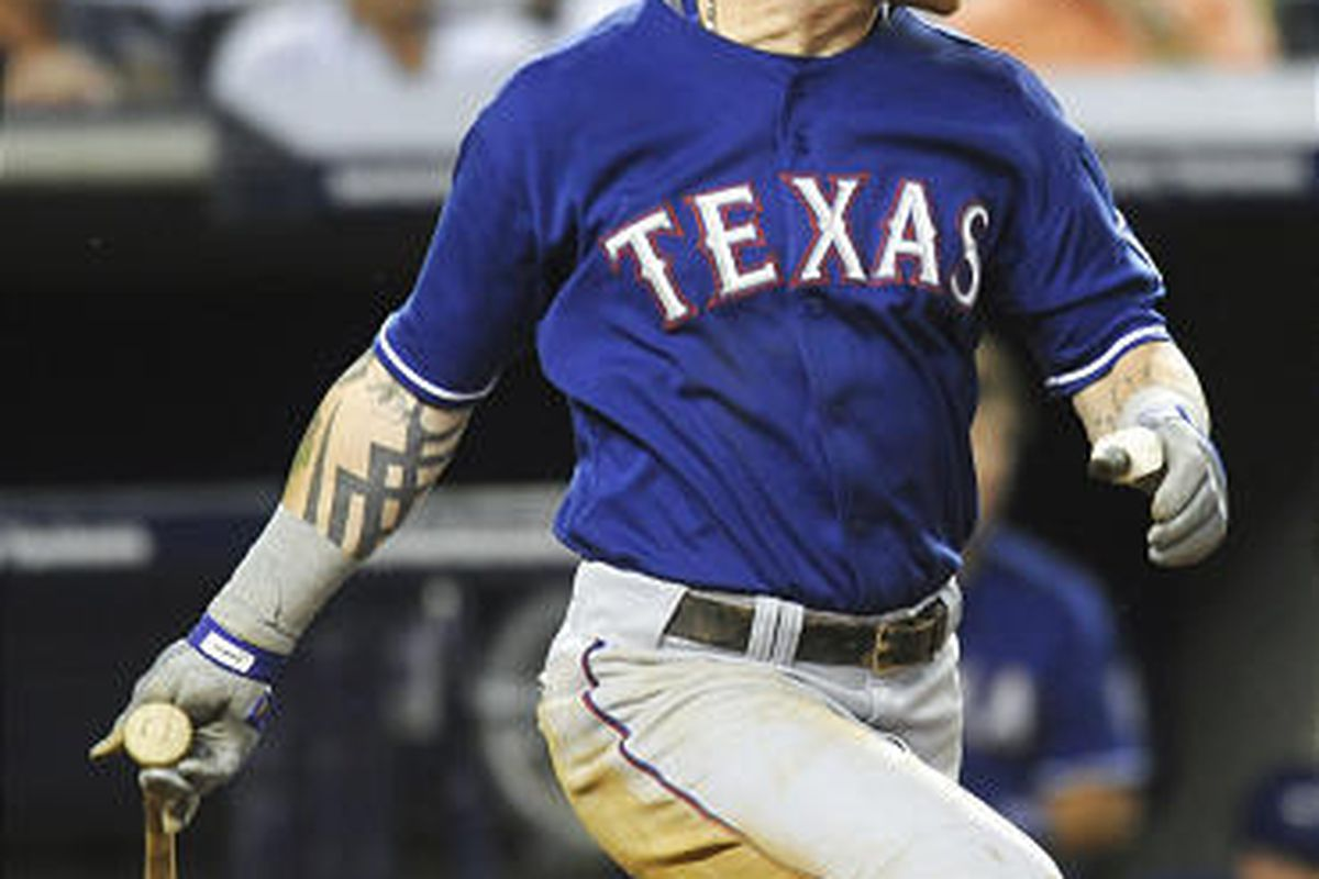 Ranger Josh Hamilton watches his two-run single in Texas' win over New York.