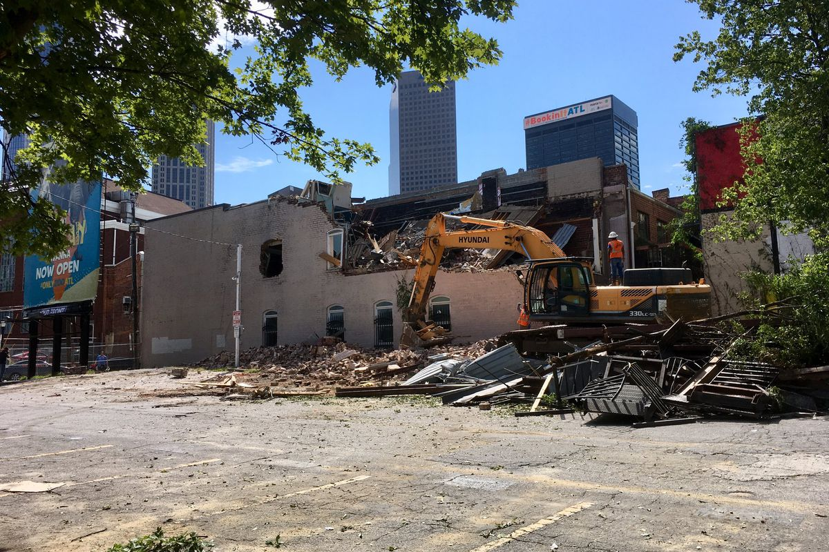 A picture of 152 Nassau Street with a big chunk ripped out of it by a backhoe.
